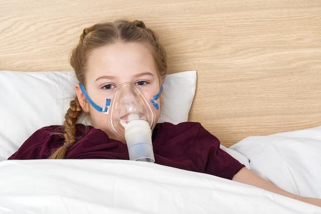 Girl with inhaler mask