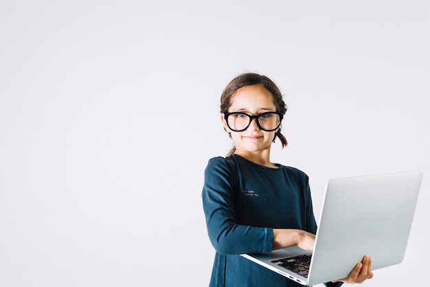 Girl with laptop looking at camera