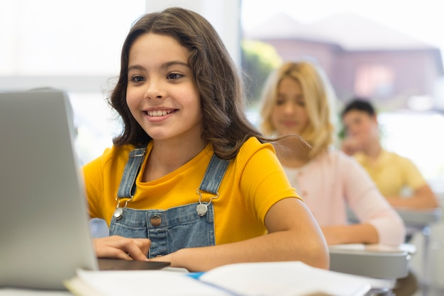 Girl with laptop at school