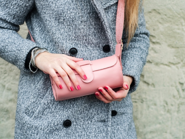 Girl with leather bag