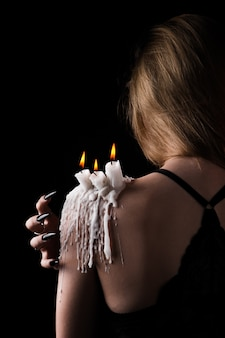 A girl with long hair of a witch is trying to set herself on fire