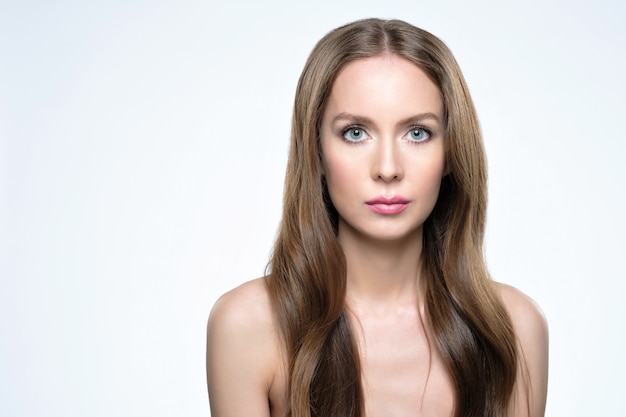 Girl with long and shiny hair. beautiful model woman with good hairstyle