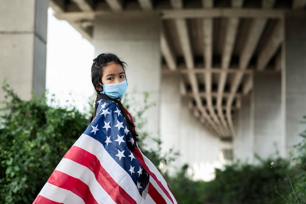 Girl with mask and american flag medium shot