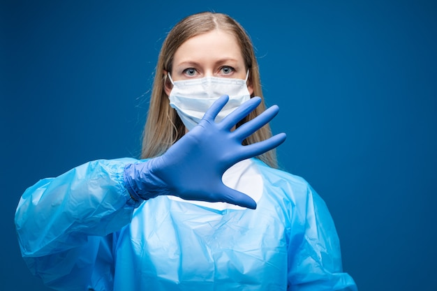 Girl with medical mask doing denial gesture