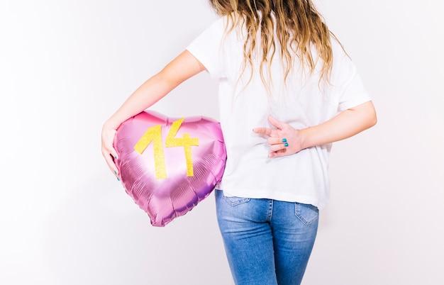 Girl with metallic balloon