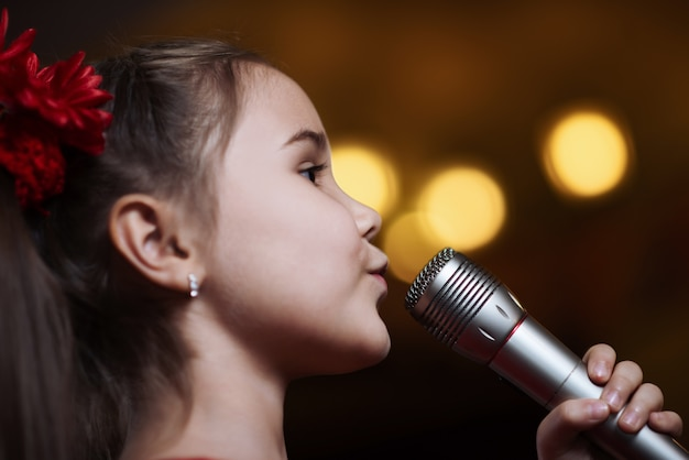 The girl with the microphone.
