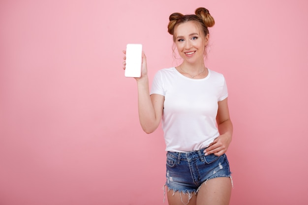 Girl with mock phone on pink space