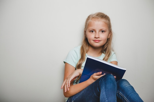 Girl with notebook sitting
