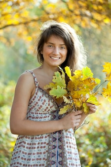 Girl with oak leaves posy