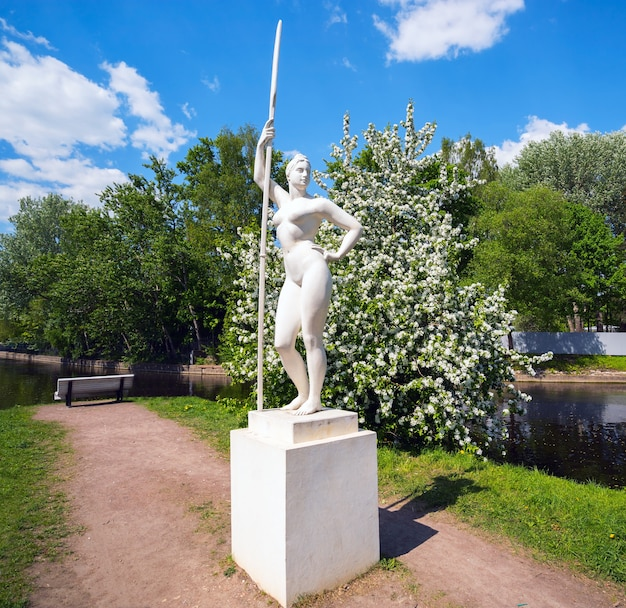 Girl with a paddle. sculpture on the nameless island of the river krestovka. saint-petersburg.