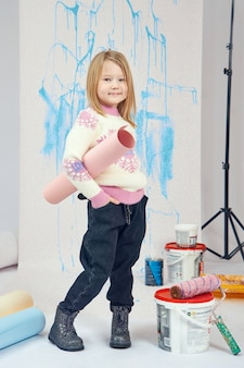 Girl with paint buckets and tools