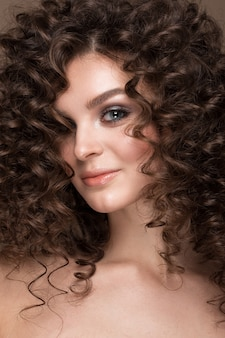 Girl with a perfectly curly hair