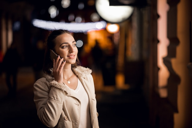 Girl with phone at night