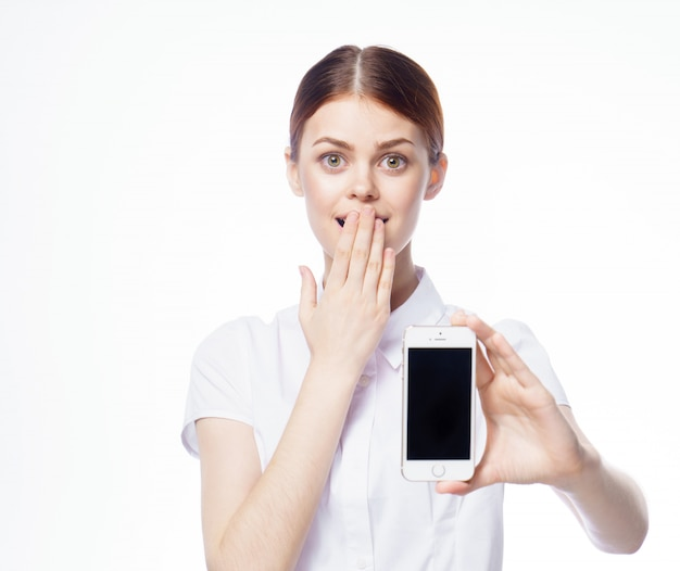 Girl with a phone, white isolated space