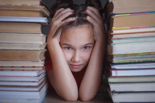Girl with piles of books