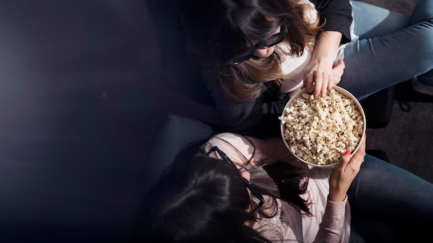 Girl with popcorn in cinema