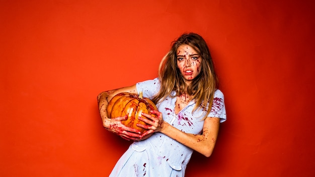 Girl with pumpkin blood lust bloody halloween crazy girl and happy halloween