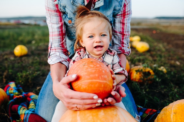 Girl with a pumpkin in front of her