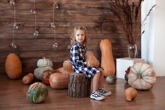Girl with pumpkin at home