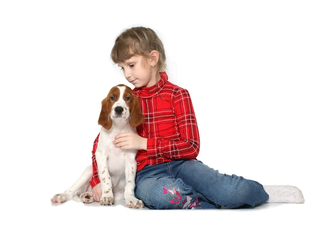The girl with a puppy of a setter