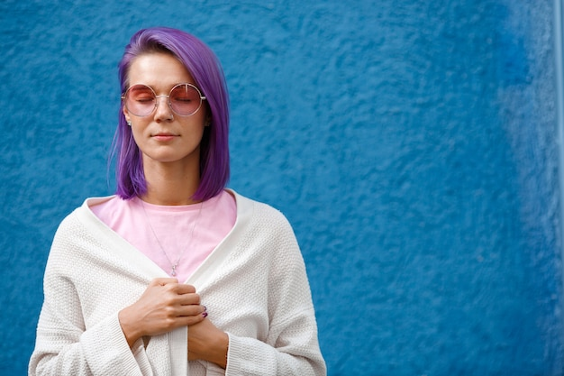 Girl with purple hair on blue
