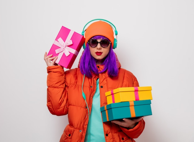 Girl with purple hair with headphones and gifts