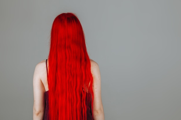 Girl with red long hair back view