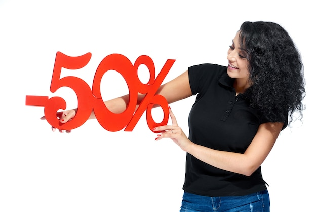 A girl with a red sign -50% sale on the white background