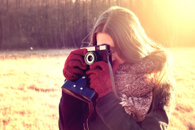 Girl with retro vintage camera.