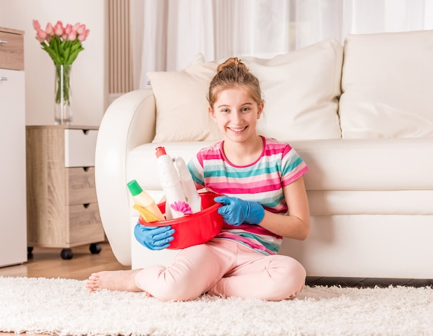 Girl with set of cleaning tools