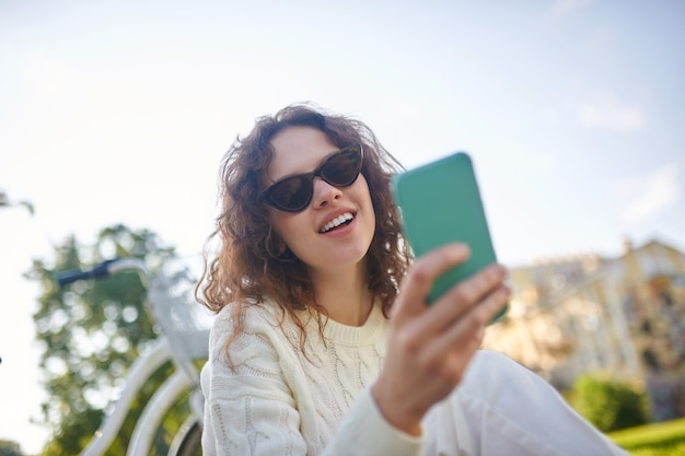 A girl with a smartphone in hands feeling wonderful