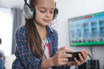 Girl with smartphone listening to music