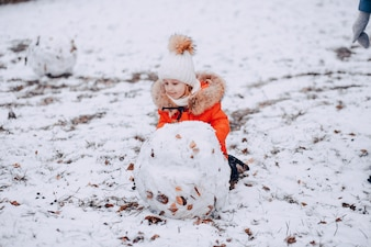 Girl with snowman