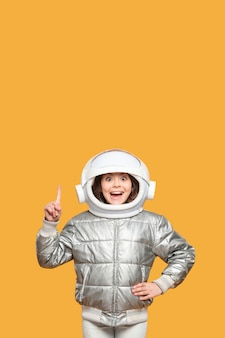 Girl with space helmet pointing