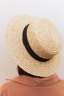Girl with a square in a straw hat