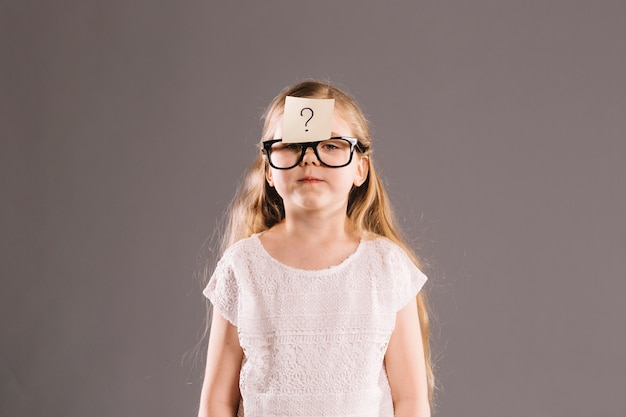 Girl with sticky note on forehead