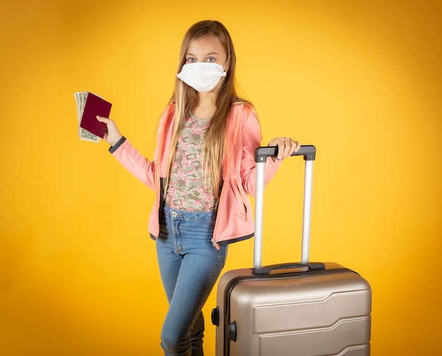 Girl with suitcase, trips canceled by covid 19