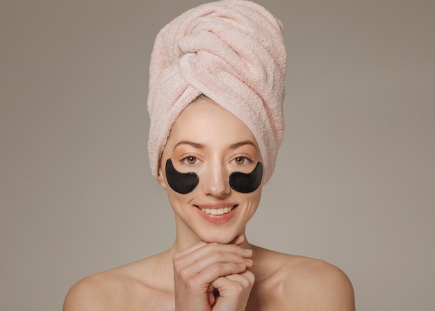 Girl with towel on the head with face mask