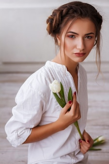 Girl with a tulip. summer look. clear skin