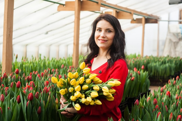 Girl with tulips grown in a greenhouse