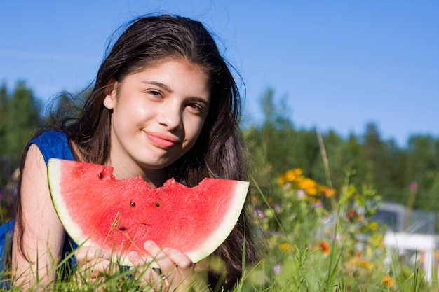Girl with watermelon in summer
