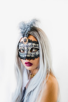 Girl with white hair with a venetian mask