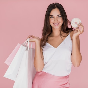Girl with white undershirt on pink background