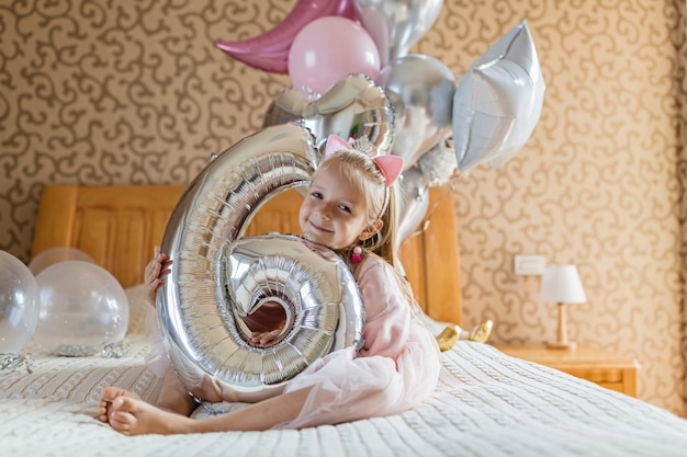 Girl with with birthday balloons