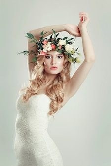 Girl with a wreath of flowers on her head
