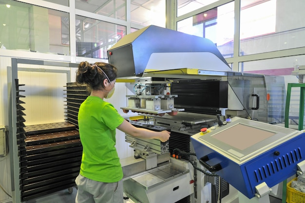 Girl at work on the production of components for assembly of ovens