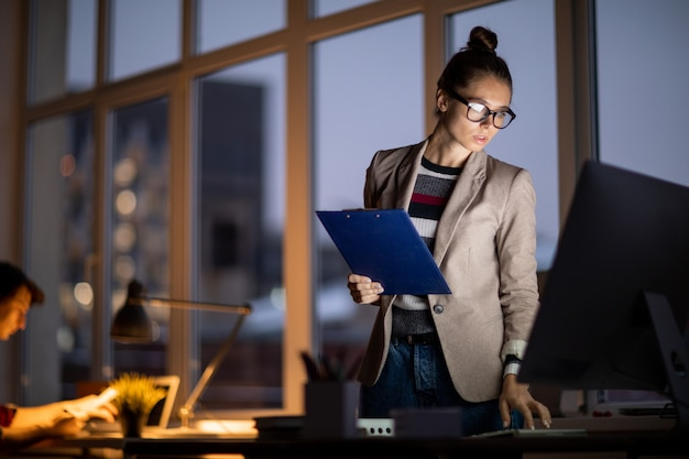 Girl working in the office at night