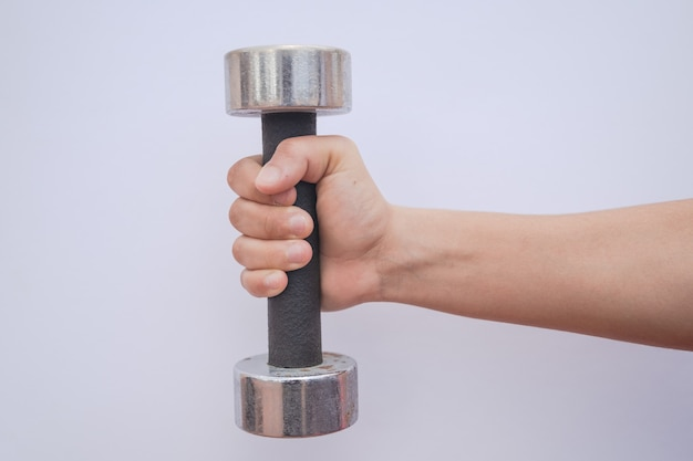A girl working out with a pair of dumbbells, perfect for biceps