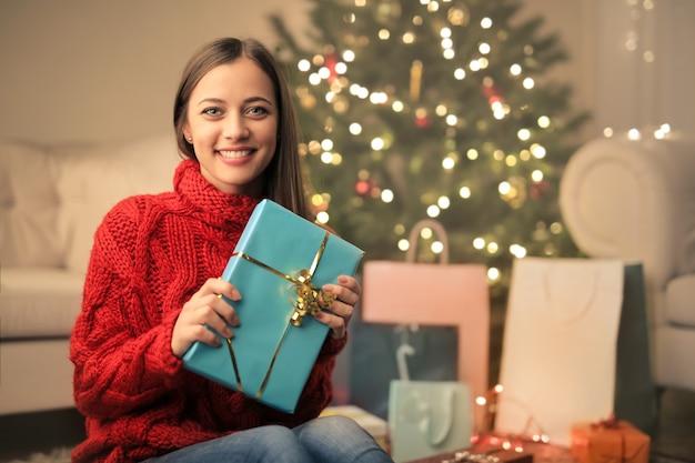 Girl wrapping christmas gifts