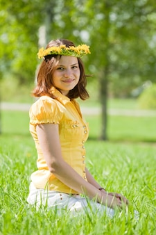 Girl in  wreath at meadow